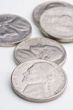 Five nickels. A pile of U.S. (american) 5 cent nickels stock photo