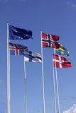 Five Nordic flags on flagpoles with EU flag. Denmark, Sweden, Norway, Finland, Iceland and European Union. Royalty Free Stock Image