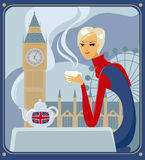 Five-o-clock tea in London. Young woman drinking english tea in a cafe in London Stock Photo