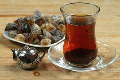 Five o'clock - tea time. Tea prepared in turkish way, cane sugar and small steel teapot. Five o'clock Stock Photo