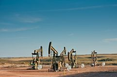 Five pumpjack in a row royalty free stock photos