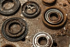 Five old bearings. In dust stock photo