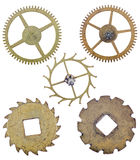 Five old brass isolated gears Stock Photography