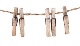 Five old clothespins on rope Royalty Free Stock Photo