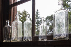 Five Old Glass Bottles Stock Photography