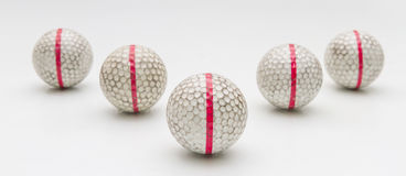 Five Old golf balls. Five Old golf balls on white background Stock Photo