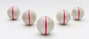Five Old golf balls. Stock Photo
