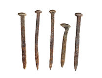 Five old rusted spikes isolated Royalty Free Stock Photography