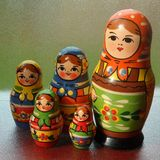 Five Are One. A set of wooden Russian nesting dolls of decreasing size. Can be placed one inside another Stock Photo