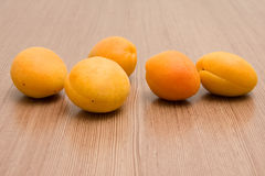 Five Orange Apricots. On the Wood Surface Stock Images