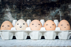 Five organic hen eggs with cute faces, bio produce Royalty Free Stock Photos