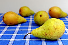 Five organic pears Stock Images