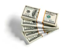 Five packs of 100 USD. American national currency on white background Stock Image