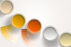 Five paint cans - yellow, orange, white on white background. Five paint cans - yellow, orange, white with paint samplers on white background Stock Image