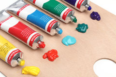 Five paint tubes over a pallete Royalty Free Stock Image