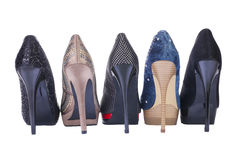 Five pair shoes of high heels Stock Photos