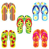 Five pairs of colorful flip flops Royalty Free Stock Photos