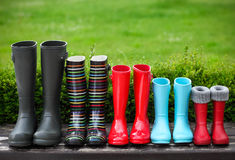 Five pairs of a colorful rain boots Stock Images