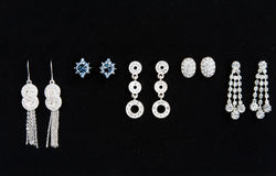 Five pairs of women's earrings Royalty Free Stock Images