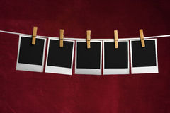 Five palaroid blank attach to rope clothes peg Stock Image