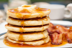 Five pancakes with dripping syrup Royalty Free Stock Images