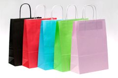 Five paper shopping bags at an angle Royalty Free Stock Photography