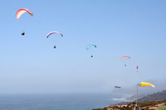Five Paragliders. Float on air above a busy gliderport Royalty Free Stock Photos