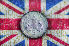 Five Pence. Money Coin on British Flag Stock Photos