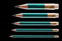 Five pencils on black. Background stock photo