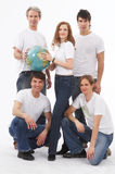 Five people with a globe stock image