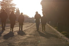 Five people going away. Five silhouettes of people going away Stock Photo