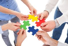 Five people hand with puzzle Royalty Free Stock Image