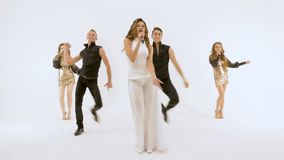 Five professional actors dancing on. They move synchronously. Five people professional actors dancing on white background. Girl-singer in a white dress Two stock footage