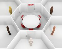 Five people standing around the closed white room with round table and closed door with a red exit sign. Meeting people to discuss Stock Image