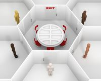 Five people standing around the closed white room with round table and closed door with a red exit sign. Meeting people to discuss Royalty Free Stock Photos