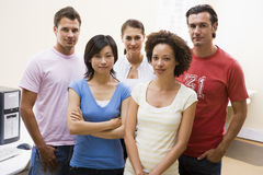 Five people standing in computer room Royalty Free Stock Photography