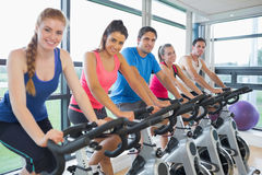 Five people working out at spinning class Royalty Free Stock Images