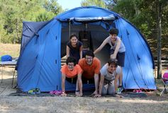 Five-person family with three children with camping tent in summ Royalty Free Stock Photography