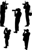 Five photographer silhouettes Royalty Free Stock Photo