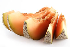 Five pieces of orange cantaloup. Five pieces of appetizing orange cantaloup Royalty Free Stock Photography