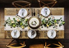 Five place settings at dining table  Stock Images