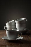 Five plain white ceramic coffee or tea cups Stock Image