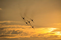 Five planes flying at sunset Royalty Free Stock Photography