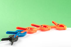 Five plastic clamps. Stock Images