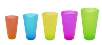Five plastic cups color yellow red blue green Stock Images