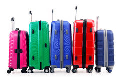 Five plastic suitcases isolated on white Royalty Free Stock Photography
