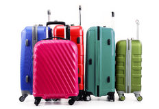 Five plastic suitcases isolated on white Stock Photos