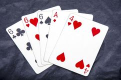 Five playing card`s stud hand three of a kind six and ace a four fun Royalty Free Stock Photo