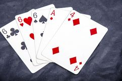 Five playing card`s stud hand three of a kind six and ace four fun royalty free stock photo