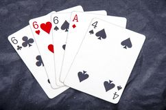 Five playing card`s stud hand three of a kind six and ace four fun royalty free stock photos